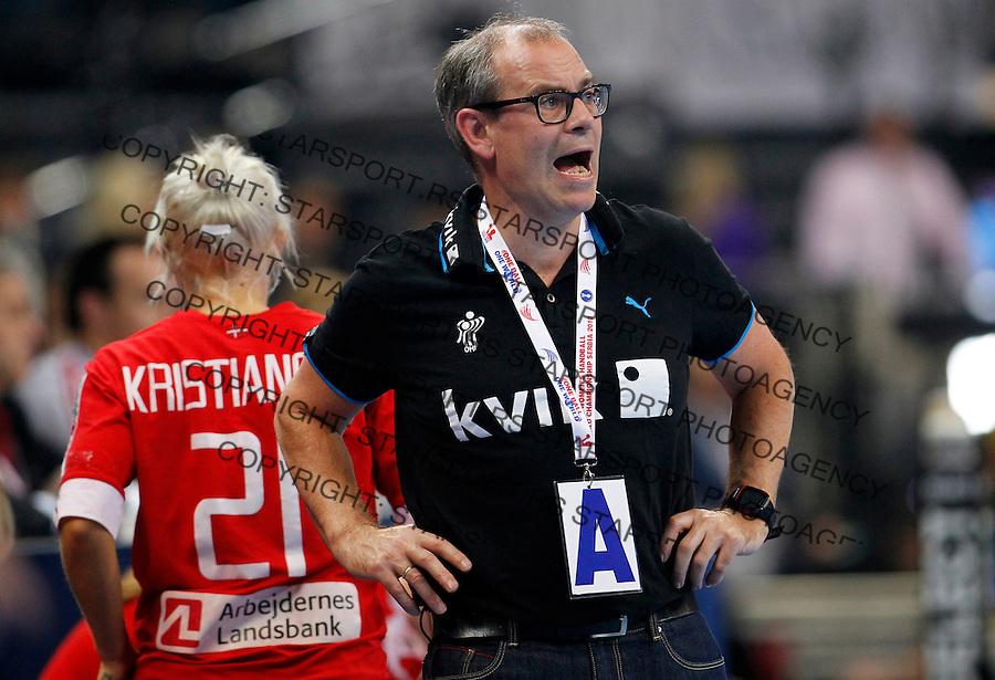 SERBIA, Belgrade: Denmark's national handball team coach Jan Pytlick (R)during handball Women's World Championship semi-final match between Brazil and Denmark in Belgrade, Serbia on Friday, December 20, 2013. (credit image & photo: Pedja Milosavljevic / STARSPORT / +318 64 1260 959 / thepedja@gmail.com)