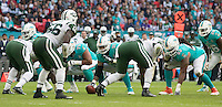 04.10.2015. Wembley Stadium, London, England. NFL International Series. Miami Dolphins versus New York Jets. Miami Dolphins Center Mike Pouncey prepare to pass the ball at the start of a play.