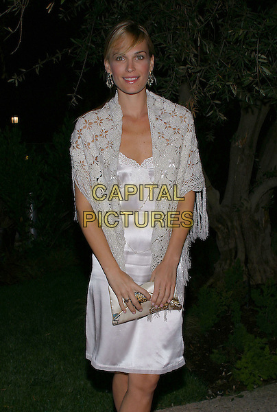 MOLLY SIMS.Endless Summer Party To Benefit The Autism Coalition and Surfers Healing held at the Esquire House. .September 30, 2004.Photo by V. Summers/AdMedia. .half length, silk, satin white dress, sahwl wrap, knitted, crochet.www.capitalpictures.com.sales@capitalpictures.com.© Capital Pictures.