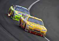 Feb 22, 2009; Fontana, CA, USA; NASCAR Sprint Cup Series driver Clint Bowyer leads Mark Martin during the Auto Club 500 at Auto Club Speedway. Mandatory Credit: Mark J. Rebilas-