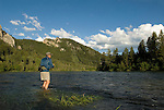 "An angler casts a fly for trout during a summer afternoon on the ""canyon section"" of the South Fork of the Snake River, Idaho."