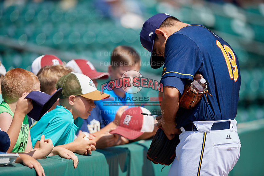 Montgomery Biscuits pitcher Roel Ramirez (19) signs autographs for fans before a game against the Biloxi Shuckers on May 8, 2018 at Montgomery Riverwalk Stadium in Montgomery, Alabama.  Montgomery defeated Biloxi 10-5.  (Mike Janes/Four Seam Images)