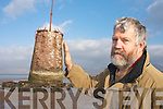 Cllr Johnny O'Connor demonstrates the angle of the Castle lighthouse, which is leaning on Rossbeigh beach.   Copyright Kerry's Eye 2008