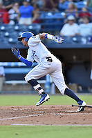 Asheville Tourists designated hitter Yonathan Daza (2) runs to first base during a game against the Augusta GreenJackets at McCormick Field on August 5, 2016 in Asheville, North Carolina. The Tourists defeated the GreenJackets 7-6. (Tony Farlow/Four Seam Images)