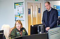 19/03/2020 - Picture released by Kensington Palace of Prince William Duke of Cambridge talking with staff during a visit to the London Ambulance Service 111 control room in Croydon on Thursday to meet ambulance staff and 111 call handlerswho have been taking NHS 111 calls from the public, and thank them for the vital work they are doing.. Photo Credit: ALPR/AdMedia