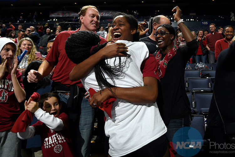 COLUMBUS, OH - DECEMBER 17:  Inky Ajanaku (12) of Stanford University celebrates the Cardinal victory over the University of Texas during the Division I Women's Volleyball Championship held at Nationwide Arena on December 17, 2016 in Columbus, Ohio.  Stanford beat Texas 3-1 to win the national title. (Photo by Jamie Schwaberow/NCAA Photos via Getty Images)