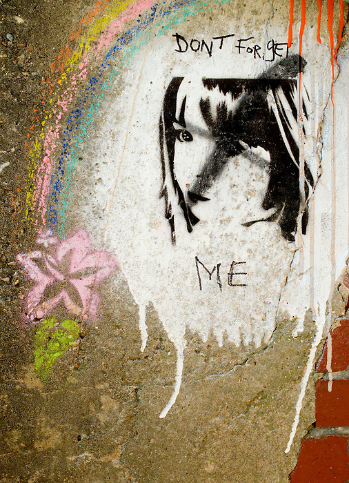 A stencil graffito on a wall at Ovingdean, Sussex, England shows the face of Madeleine McCann with the words 'Don't forget me'. Madeleine McCann disappeared on May 17, 2007.