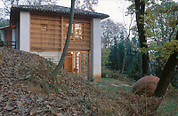 The woodlands around this Kozolec inspired house have been allowed to grow naturally with little human intervention