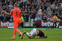 Jordan Pickford kicks Marko Arnautovic of West Ham after Manuel Lanzini of West Ham scored the third goal during West Ham United vs Everton, Premier League Football at The London Stadium on 13th May 2018