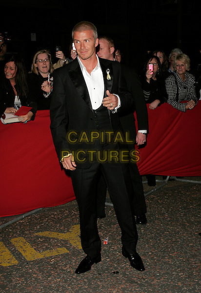 DAVID BECKHAM.Wearing a yellow ribbon in support of the Find Madeline McCann Campaign.Arrivals - Greatest Britons 2007 Awards Show, .The London Studios, London, Engand, May 21st 2007..full length black suit white shirt shoes waistcoat.CAP/AH.©Adam Houghton/Capital Pictures.