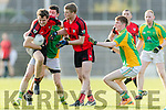 David Hallissey and Kevin O' Sullivan Kenmare in action against Pat Connole and Matthew Egan Matthew Egan Kilfenora in the Munster Intermediate Club Football Championship Semi-Final at Fitzgerald Stadium on Sunday.