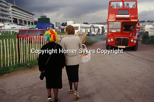 The Derby Horse race Epsom Downs Surrey Uk Circa 1985. Lady wearing colourful wig.