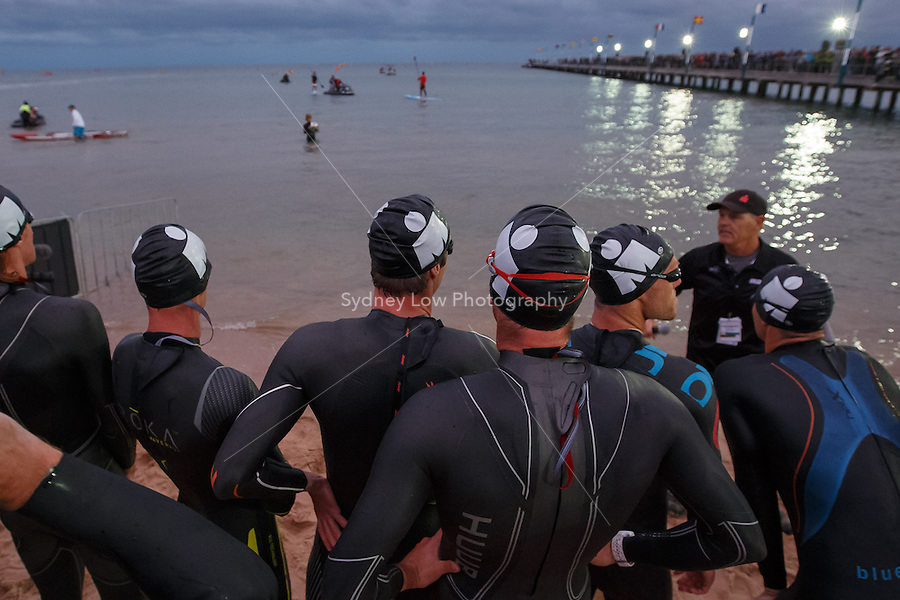 The Pro-Men racers prepare to start the swim leg at the IRONMAN Asia-Pacific Championship in Melbourne, Australia on Sunday March 23, 2014. (Photo Sydney Low / sydlow.com)