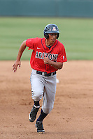 Ryan Aguilar (21) of the Arizona Wildcats runs the bases during a game against the UCLA Bruins at Jackie Robinson Stadium on May 16, 2015 in Los Angeles, California. UCLA defeated Arizona, 6-0. (Larry Goren/Four Seam Images)