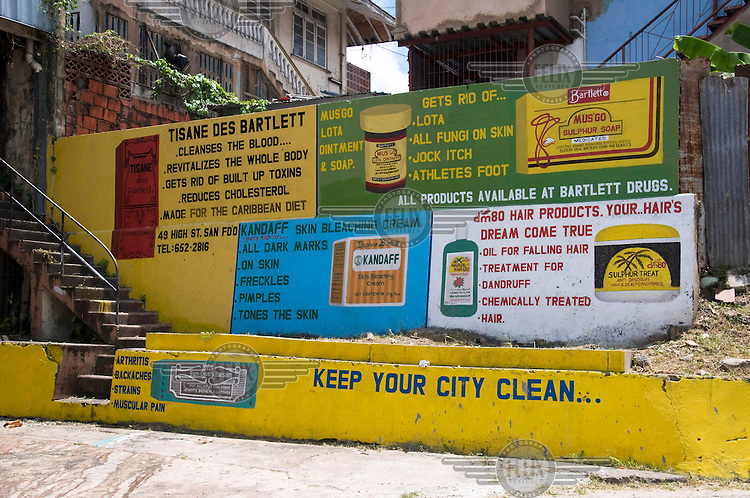 Painted wall with advertisements for a range of dubious health and beauty treatments.