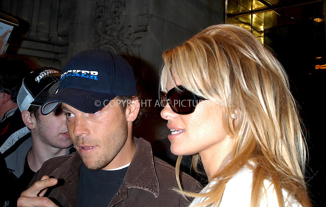 pam anderson and stephen dorf leave hotel for a night on the town.  bocklet