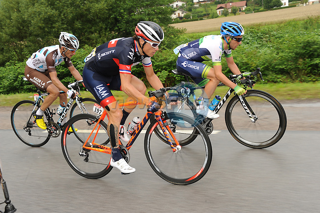 The breakaway group including Sylvain Chavanel (FRA) IAM Cycling, Simon Yates (GBR) Orica Greenedge and Blel Kadri (FRA) AG2R La Mondiale during Stage 8 of the 2014 Tour de France running 161km from Tomblaine to Gerardmer La Mauselaine. 12th July 2014.<br /> Photo ASO/B.Bade/www.newsfile.ie