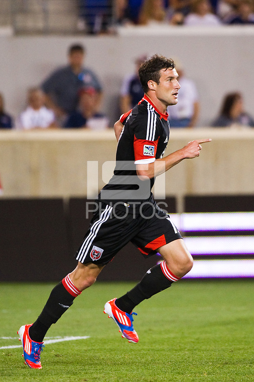 Chris Pontius (13) of DC United celebrates scoring. The New York Red Bulls defeated DC United 3-2 during a Major League Soccer (MLS) match at Red Bull Arena in Harrison, NJ, on June 24, 2012.