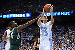 30 December 2014: North Carolina's Justin Jackson (44) is fouled by William and Mary's Daniel Dixon (0). The University of North Carolina Tar Heels played the College of William & Mary Tribe in an NCAA Division I Men's basketball game at the Dean E. Smith Center in Chapel Hill, North Carolina. UNC won the game 86-64.