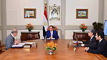 Egyptian President Abdel Fattah al-Sisi meets with Prime Minister Sharif Ismail, in Cairo, Egypt, on May 24, 2018. Photo by Egyptian President Office