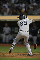 OAKLAND, CA - AUGUST 20:  Gio Urshela #29 of the New York Yankees bats against the Oakland Athletics during the game at the Oakland Coliseum on Tuesday, August 20, 2019 in Oakland, California. (Photo by Brad Mangin)