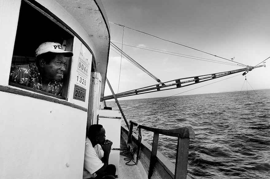 Gullah shrimpers Gene Orage and Diogenese Miller aboard the Rip Tide.