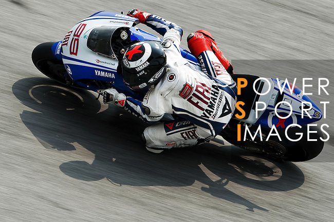 KUALA LUMPUR, MALAYSIA - OCTOBER 24: Jorge Lorenzo of Spain rides the #99 Fiat Yamaha Team Yamaha during free practice for the Malaysian MotoGP, which is round 16 of the MotoGP World Championship at the Sepang Circuit on October 24, 2009 in Kuala Lumpur, Malaysia.  Photo by Victor Fraile / The Power of Sport Images