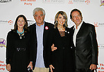 HOLLYWOOD, CA. - October 03: Richard Donner, wife Lauren Shuler Donner, Eric Idle and wife Tania arrive at the Best Friends Animal Society's 2009 Lint Roller Party at the Hollywood Palladium on October 3, 2009 in Hollywood, California.
