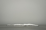 Gull Rock in winter with snow. Madison, CT.