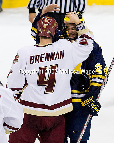 USNDTP teammates Mike Brennan (BC 4) and Chad Kolarik (Michigan 24) - The University of Michigan Wolverines defeated the Boston College Eagles 4-3 in overtime in the opening game of the Ice Breaker Tournament on Friday, October 12, 2007, at the Xcel Energy Center in St. Paul, Minnesota.