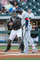 Erik Gonzalez (11) of the Columbus Clippers is tagged out by Charlotte Knights catcher Omar Narvaez (14) after striking out in the top of the first inning at BB&T BallPark on May 3, 2016 in Charlotte, North Carolina.  The Clippers defeated the Knights 8-3.  (Brian Westerholt/Four Seam Images)