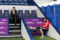 Pictured L-R: Swansea manager Michael Laudrup speaks on his mobile phone while scout Erik Larsen seems to be texting on his. Sunday 01 September 2013<br />