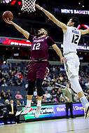 Washington, DC - MAR 7, 2018: Fordham Rams guard Joseph Chartouny (12) goes up for a lay up against George Washington Colonials guard Yuta Watanabe (12) during game between G.W. and Fordham during first round action of the Atlantic 10 Basketball Tournament at the Capital One Arena in Washington, DC. (Photo by Phil Peters/Media Images International)