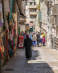 A Muslim woman in traditional dress in the Muslim Quarter of the Old City of Jerusalem.  The Old City of Jerusalem and its Walls is a UNESCO World Heritage Site.