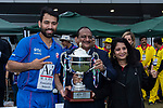 Babar Hayatof Kowloon Cantons (L) is presented with the trophy by Sanjay Bhimsaria, Managing Director of the DTC Mobile (C), and Sangita Bhimsaria of the DTC Mobile, (R) after the team winning the final match of the Hong Kong T20 Blitz between Kowloon Cantons and City Kaitak at Tin Kwong Road Recreation Ground, Hong Kong, China. Photo by Chris Wong / Power Sport Images