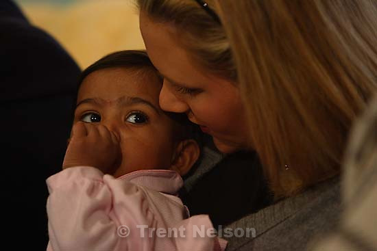 "Salt Lake City - Asha has developed an affection for her new sister Liddy Huntsman (18). Liddy said, ""I think she thinks I'm her mother."" The Huntsman family introduced their new adopted daughter Asha to Utah at a Friday press conference held in the Governor's Mansion."