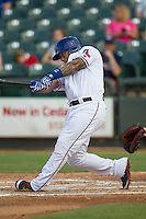 Round Rock Express outfielder Michael Choice (20) swings the bat during the second game of a Pacific Coast League doubleheader against the Memphis Redbirds on August 3, 2014 at the Dell Diamond in Round Rock, Texas. The Redbirds defeated the Express 7-6. (Andrew Woolley/Four Seam Images)