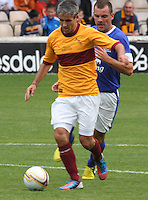 Keith Lasley pressured by Darron Gibson in the Motherwell v Everton friendly match at Fir Park, Motherwell on 21.7.12 for Steven Hammell's Testimonial.