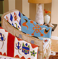 Close-up of a beaded African chair in the living room