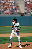 OAKLAND, CA - Dennis Eckersley of the Oakland Athletics pumps his fist and celebrates after getting a save against the California Angels at turn back the clock day at the Oakland Coliseum in Oakland, California in 1992. (Photo by Brad Mangin)