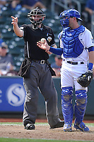 Home plate umpire Brent Hertzog call a strike during the game between the Las Vegas 51s and the Omaha Storm Chasers at Werner Park on August 17, 2014 in Omaha, Nebraska. The Storm Chasers  won 4-0.   (Dennis Hubbard/Four Seam Images)