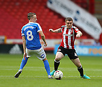 John Fleck of Sheffield Utd wrong foots Chris Forrester of Peterborough Utd during the League One match at Bramall Lane Stadium, Sheffield. Picture date: September 17th, 2016. Pic Simon Bellis/Sportimage