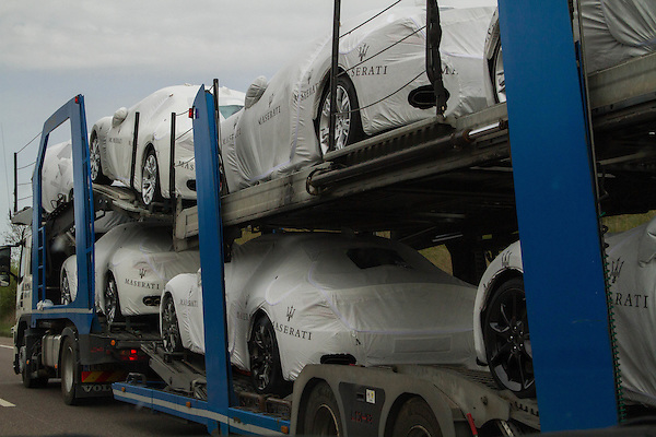 Maserati cars being transported by truck, France,