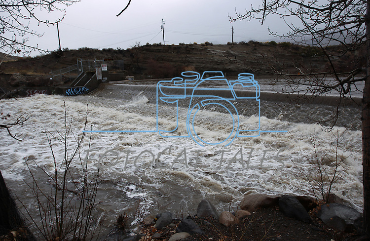 The Truckee River, seen in Verdi, Nev., east of Reno, swells as a heavy, wet storm hits Northern Nevada on Sunday, Dec. 2, 2012. (AP Photo/Cathleen Allison)