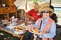The 21st annual Lincoln County Cowboy Symposium was held in October 2010 at the Ruidoso Downs Racetrack in Ruidoso, New Mexico. A visitor with a plate served up by Dexter Spalding of the C4B chuckwagon out of Amarillo, Texas.