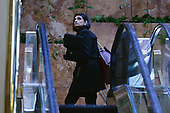 Seems Verma, president-elect's choice for Centers for Medicare and Medicaid Services administrator, is seen going up the escalators in the lobby of the Trump Tower in New York, NY, on January 10, 2017. <br /> Credit: Anthony Behar / Pool via CNP