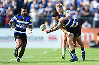 Matt Banahan of Bath Rugby offloads the ball after being tackled. Aviva Premiership match, between Bath Rugby and Newcastle Falcons on September 23, 2017 at the Recreation Ground in Bath, England. Photo by: Patrick Khachfe / Onside Images