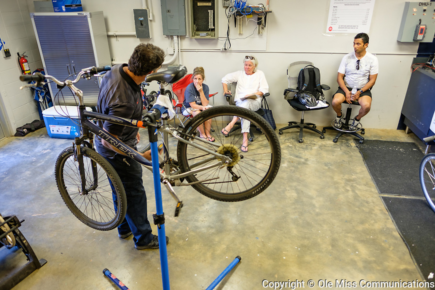 Bicycle technician Stephen Valliant shows how the gears work in a bike maintenance class as part of Staff Appreciation Week. Photo by Robert Jordan/Ole Miss Communications
