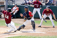 July 6, 2008: Everett AquaSox catcher Fleming Baez awaits the throw to the plate while the Yakima Bears' Alfredo Marte slides into home.