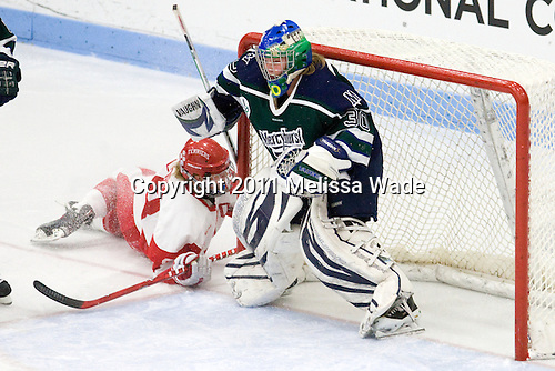 Holly Lorms (BU - 8), Hillary Pattenden (Mercyhurst - 30) - The Boston University Terriers defeated the visiting Mercyhurst College Lakers 4-2 in their NCAA Quarterfinal matchup on Saturday, March 12, 2011, at Walter Brown Arena in Boston, Massachusetts.